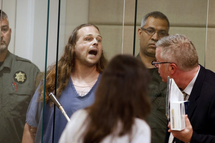 Jeremy Joseph Christian shouts as he is arraigned in Multnomah County Circuit Court in Portland, Oregon, on May 30. Authorities say Christian started verbally abusing two young women, including one wearing a hijab, on a train and when three men intervened, police say, Christian attacked them, killing two and wounding one.