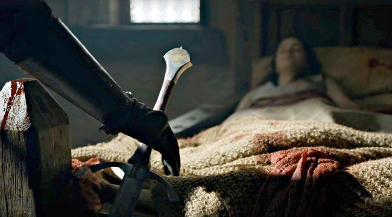 Young Ned enters the room and places a sword at the end of Lyanna's bed. The weapon in question is Dawn, the ancestral sword of House Dayne, which Ned has just taken from Ser Arthur Dayne after he and Howland Reed killed the legendary Kingsguard.Dawn is literally a falling star – unlike most ancestral swords that are made of Valyrian Steel, Dawn was forged from a meteorite. And, seeing as it was just used to kill a bunch of Northmen, it's covered in blood. So, you might say it's a ~bleeding star~, and that Jon was born ~beneath~ it.
