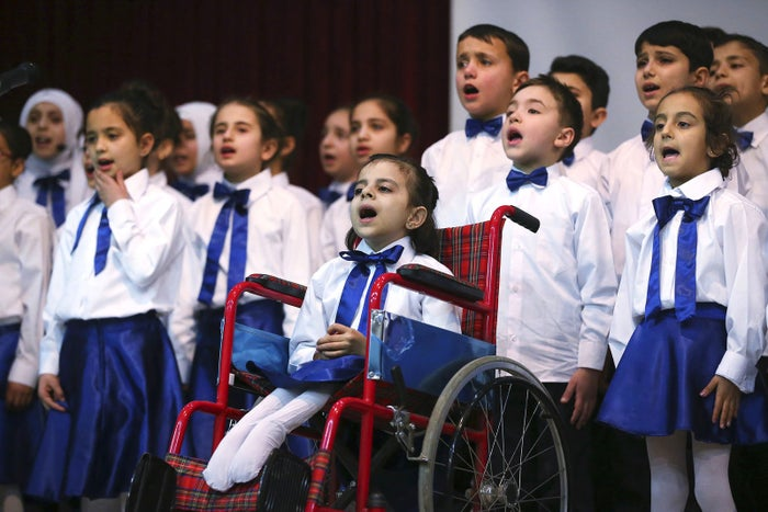 Hibeh, center in wheelchair, a Syrian refugee child from Aleppo, performs accompanied by other children during a celebratory ceremony in Gaziantep, southeastern Turkey, on March 20, 2017.