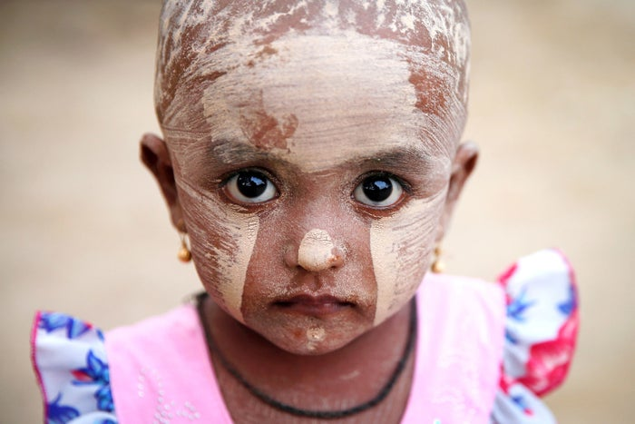 A girl wears thanakha powder on her face in a Rohingya refugee camp outside Kyaukpyu, Myanmar, on May 17, 2017.