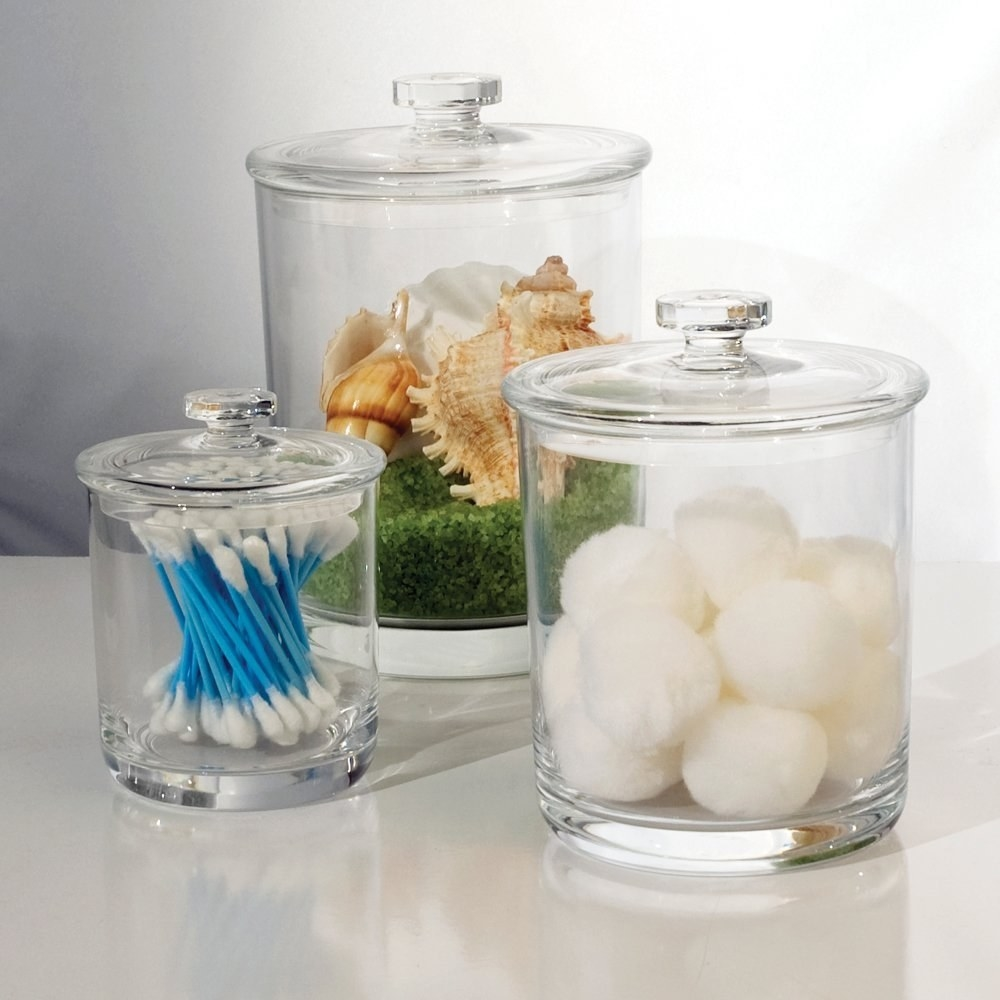 The set of jars filled with cotton swabs, balls, and decor