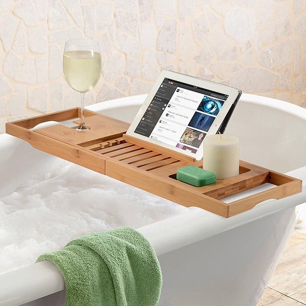 The bath caddy secured on a bathtub