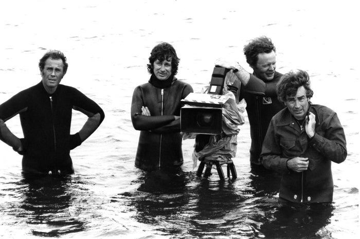 Director Steven Spielberg (center) and camera crew on the set of Jaws in 1974.
