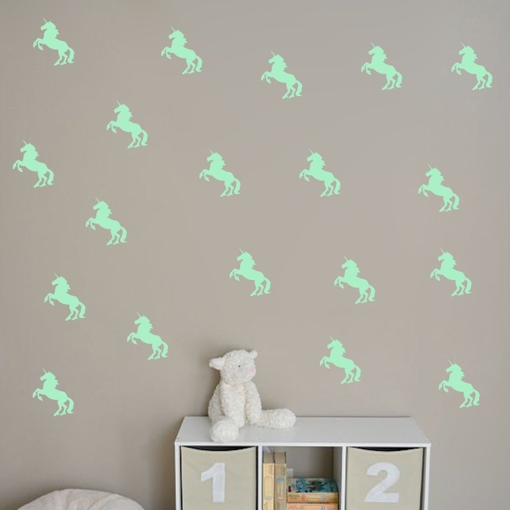32 unique pieces of decor you ll want to have on your walls asap 23 a set of 10 glow in the dark unicorns to create a truly magical room