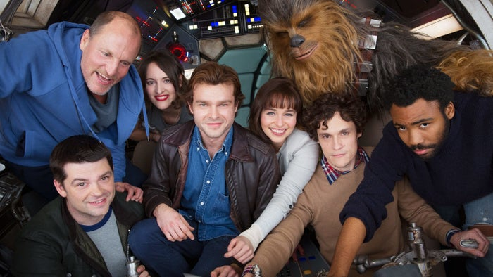 Christopher Miller, Woody Harrelson, Phoebe Waller-Bridge, Alden Ehrenreich, Emilia Clarke, Joonas Suotamo as Chewbacca, Phil Lord, and Donald Glover on the set of the Han Solo movie.