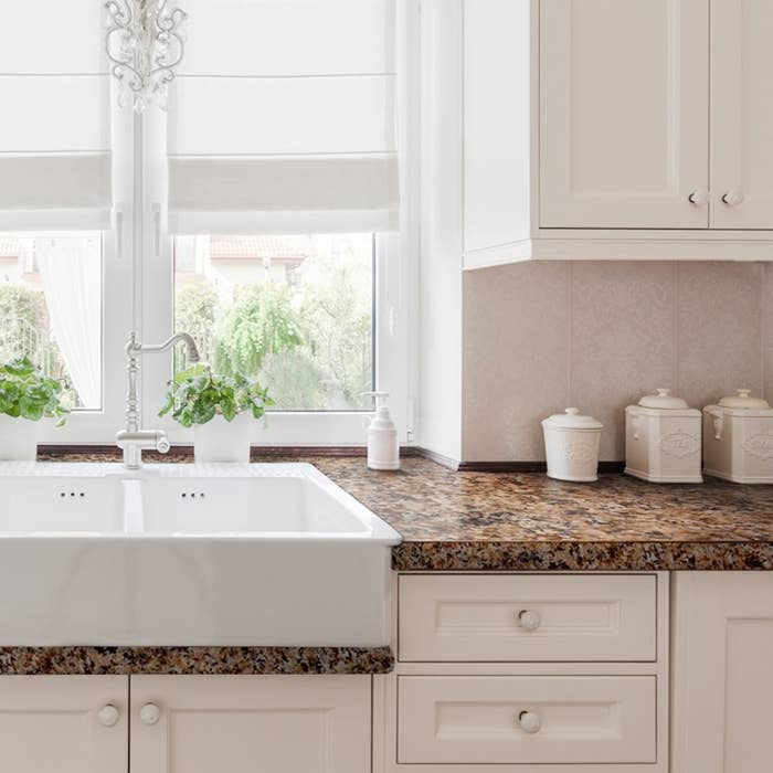 """Promising review: """"So after we got a couple bids to get new countertops, and they came in from $1200 to $1400 for basic laminate, we figured this would be worth a shot. It took some time, but it turned out GREAT!!! Everybody can't believe it's not real granite or at least brand new laminate. I'd recommend this product to anybody — after six months, it is holding up great and still looks new, with no chips or scratches. Spend $80, not $1000+. Try it!"""" —JakeWatch the full tutorial from Giani on YouTube here.Get a large kit (enough for a kitchen) from Amazon for $74.89."""
