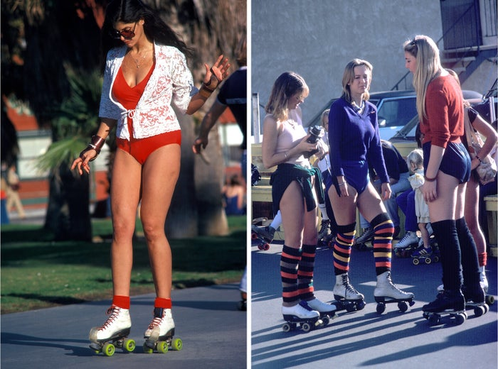 A woman (left) roller-skates, and a group of girls (right) get ready for a skate, at Venice Beach, California, 1979.
