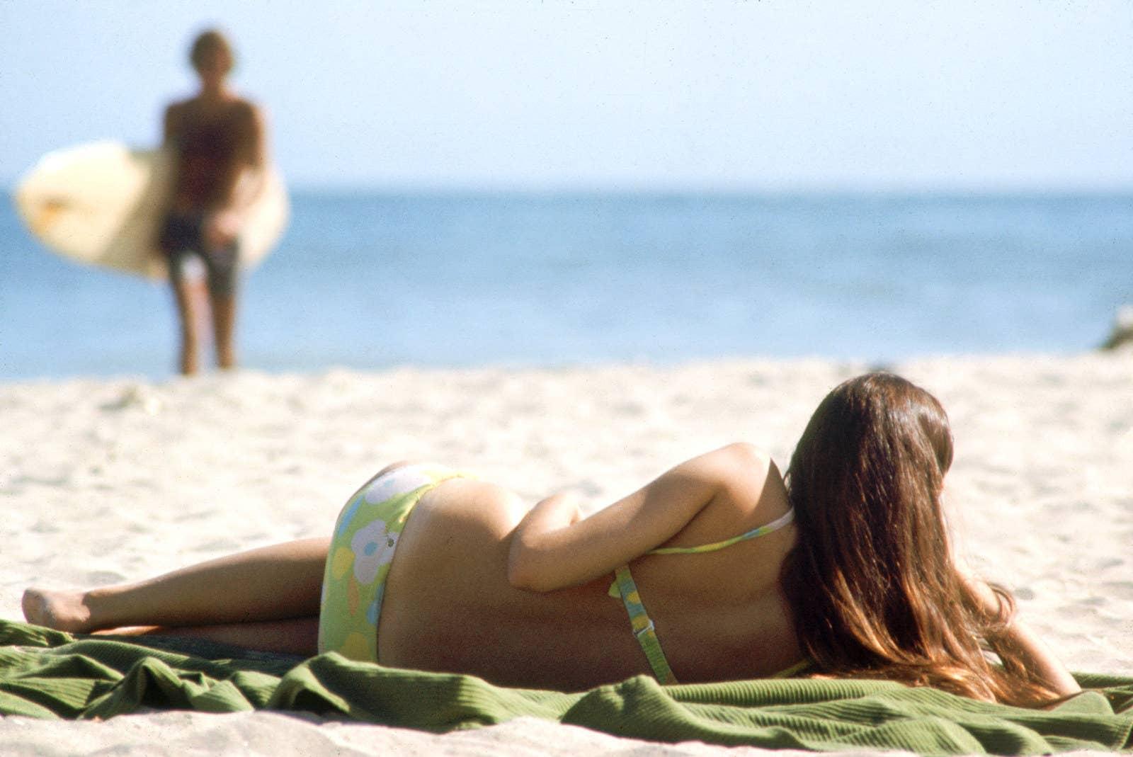 A beachgoer soaks up the sun in Malibu, 1970.