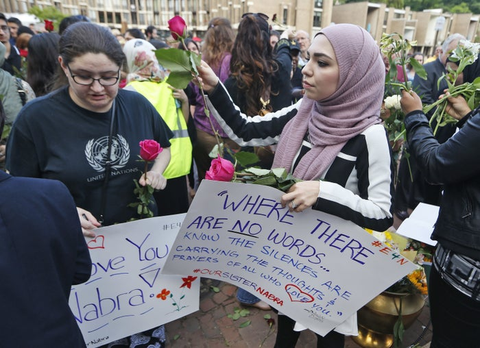 Supporters of Nabra Hassanen, who was killed over the weekend in a road rage incident, hand out flowers prior to the start of a vigil on Wednesday.