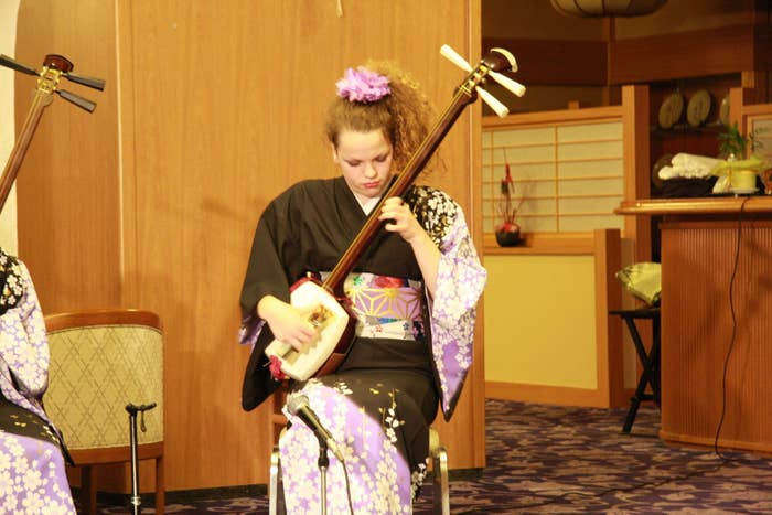 Me performing on a traditional Japanese instrument called the shamisen in my hometown of Yamagata.
