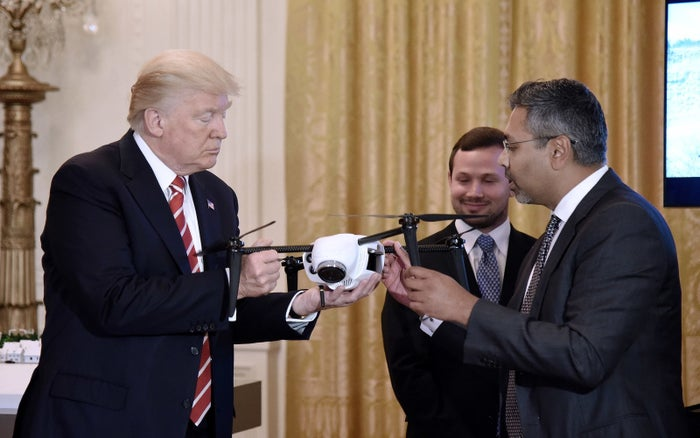 President Donald Trump holds a drone with Kespry CEO George Mathew.
