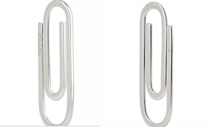 """According to the store, the product is actually a """"paperclip-shaped money clip."""" Of course, it has the words Prada on one side, so everyone knows you're bougie.It is about 6.25cm long and 2.25cm wide and made in Italy!"""