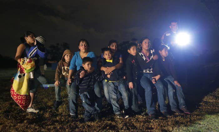 In this June 25, 2014 photo, a group of migrants from Honduras and El Salvador who crossed the U.S.-Mexico border are detained in Granjeno, Texas.