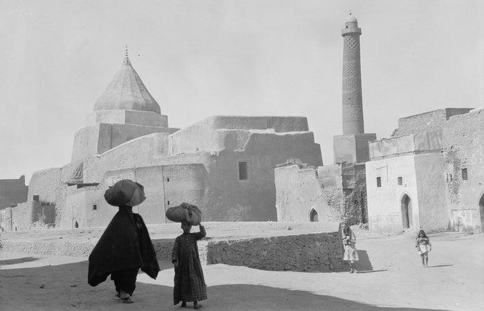 This 1932 photo shows the minaret next to a Yazidi shrine.