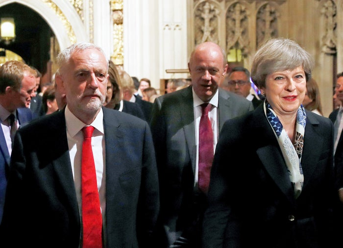 Theresa May and Jeremy Corbyn, walk through the Peers Lobby in the Houses of Parliament during the State Opening of Parliament.