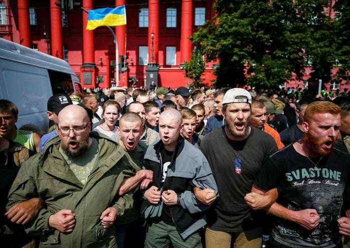 Anti-LGBT protesters in Kiev join arms during the equality march on June 18.