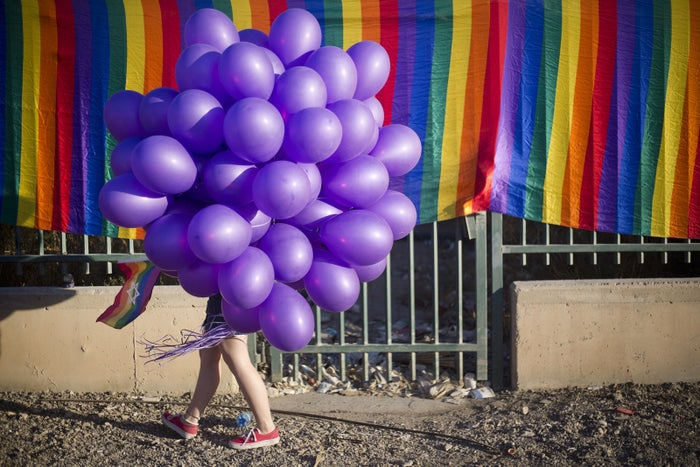 A woman holding balloons joins upwards to 3,500 people marching in the first Gay Pride Parade in Beersheba, Israel, on June 22.