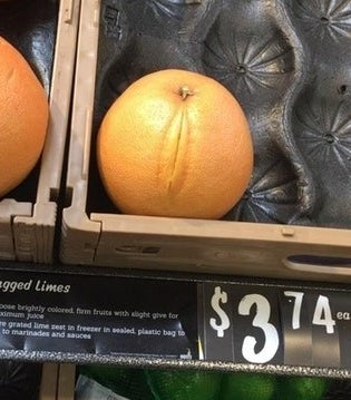 An orange with a line down one side