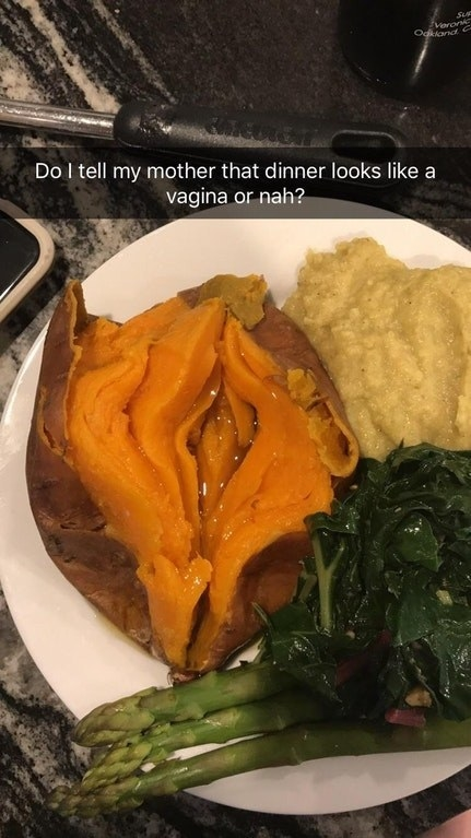 A buttered yam split in half