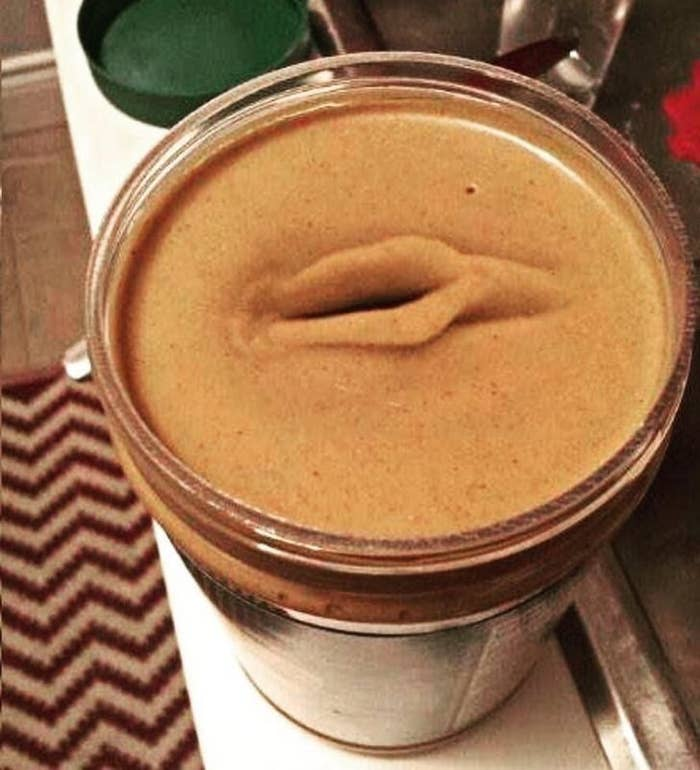 a jar of peanut butter with a hole in the middle