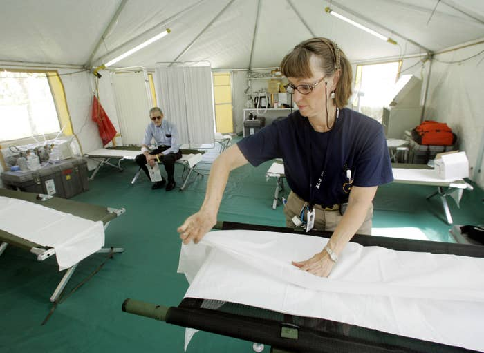 Nurse Ann Hetrick Prepares A Cot In Disaster Medical Assistance Team DMAT Tent