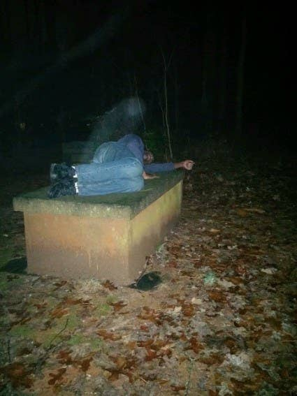 """This is a photo of my uncle that my mom took one night in a cemetery by a bar they were at. He is lying on a Revolutionary War-era grave.""—kelseywinecoff"