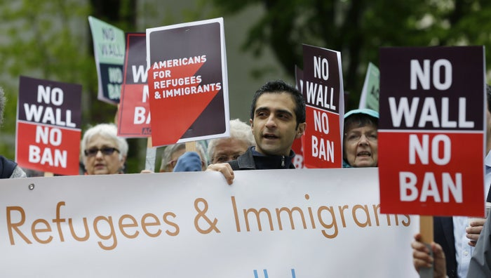Protesters demonstrate against President Trump's revised travel ban in May