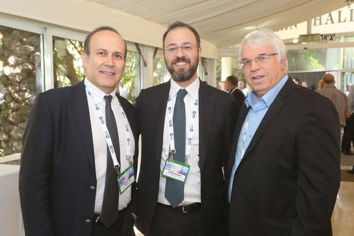 Kamil Ekim Alptekin (center) stands with Namik Tan, former Turkish ambassador to Israel and the US, at an energy conference they attended last year as guests of Ratio Oil Exploration. Standing to their right is Aron Liel, a former Israeli envoy to Turkey who is unconnected to Ratio or Alptekin's business dealings.