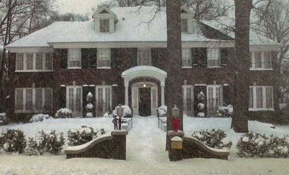 """A screenshot of the brick mansion used in """"Home Alone"""" covered with lots of snow"""