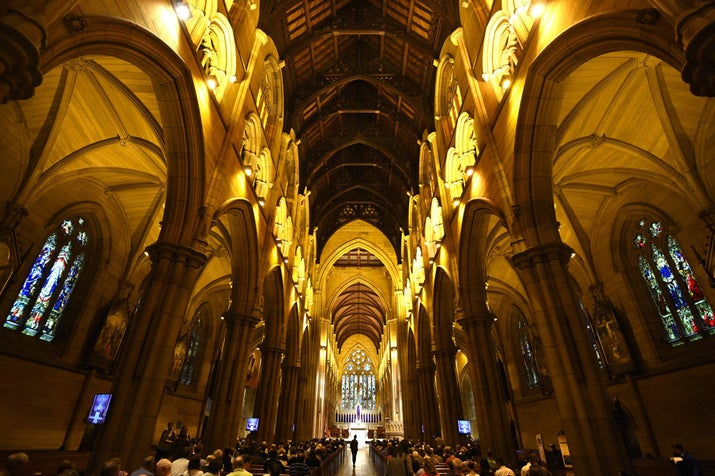 Worshippers gather for The Stations of the Cross as part of Good Friday Easter services at St Mary's Cathedral in Sydney.