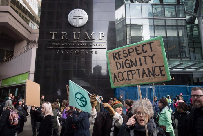 People march past the Trump Tower in Vancouver during the Women's March against US President Donald Trump.