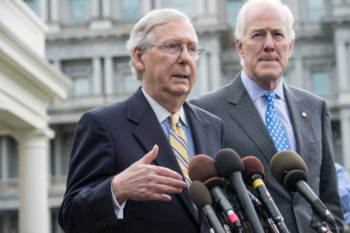 Senate Majority Leader Mitch McConnell and Majority Whip John Cornyn speak to the press after Republican senators met with President Donald Trump to discuss the health care bill on June 27.