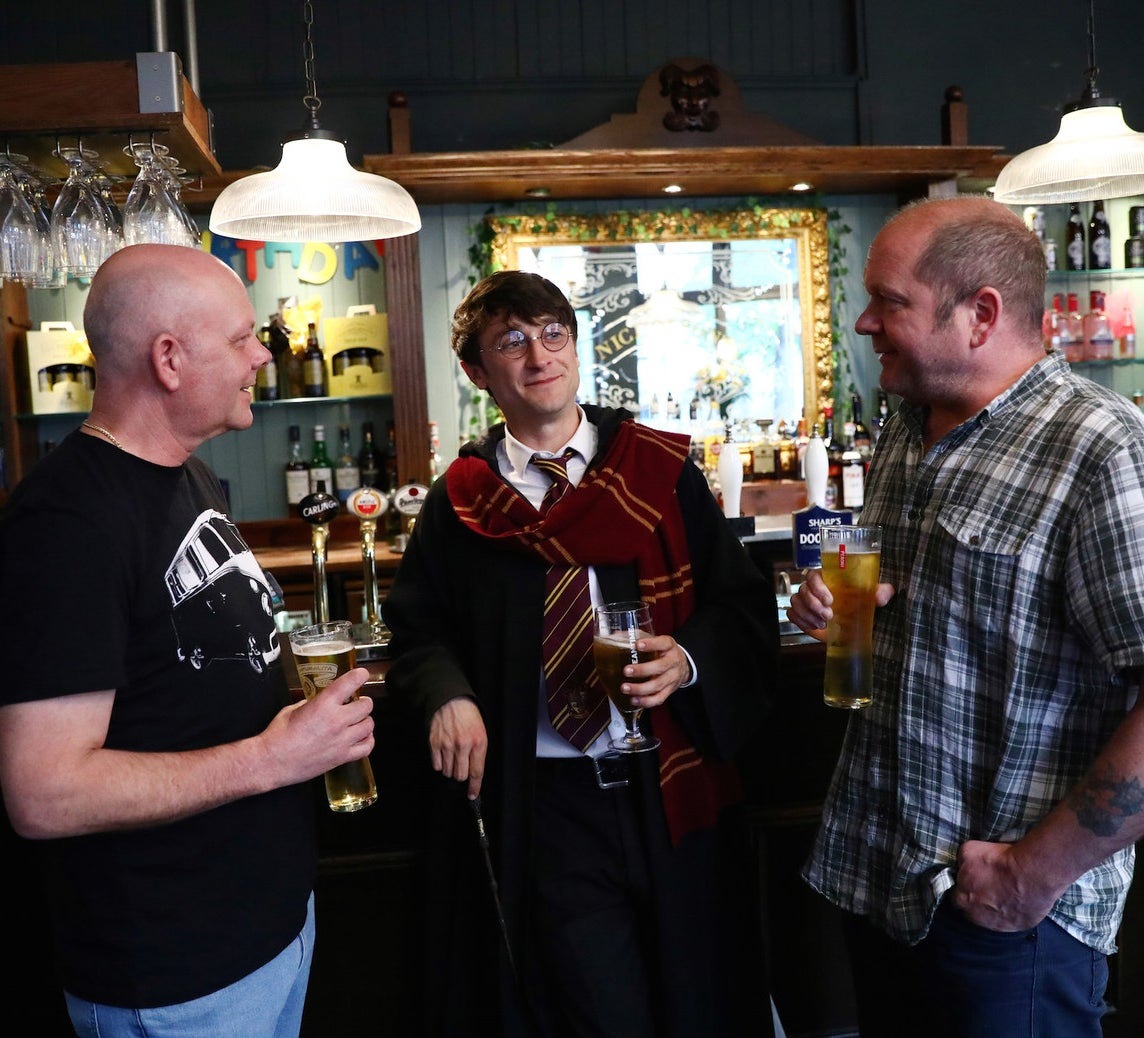 Professional Harry Potter impersonator Luke Williams enjoys a drink at a pub in London.