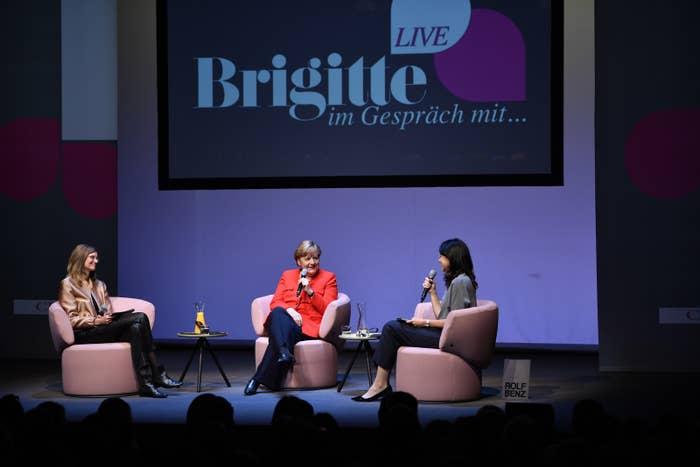 Meike Dinklage, German chancellor Angela Merkel (CDU) and Brigitte Huber speak on stage during the Brigitte Live Event on 26 June.