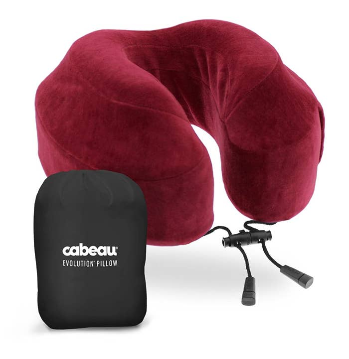cd882e8473 A memory foam travel pillow that'll let you can bring the comfort of your  bed with you onboard.