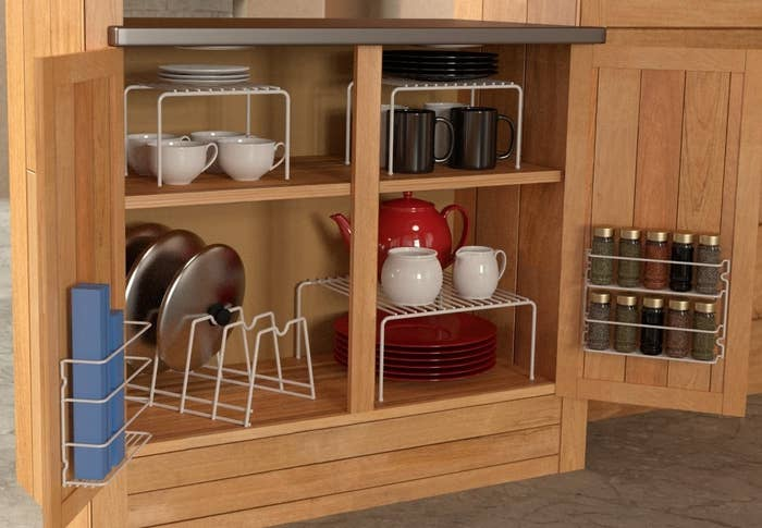 """Get a six-piece set from Amazon for $23.11.Promising review: """"I love how organized my shelf is now! It fits in perfectly and is very sturdy. Getting six pieces for less than $5 each is amazing. I put pans and lids, plates, spices, and saran wraps, and I used one of the racks for organizing my coffee stuff."""" —Barbara"""