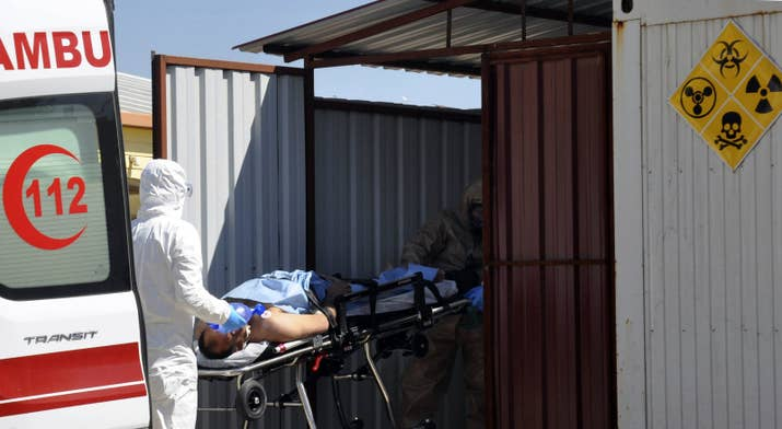Turkish experts evacuate a victim of a suspected chemical weapons attack.