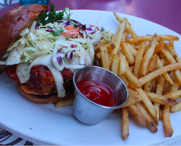Where you can get it: Carnation Café on Main Street, U.S.A. at Disneyland.What we know about it: This tasty sandwich has a kick, and comes topped with coleslaw and Sriracha honey sauce.