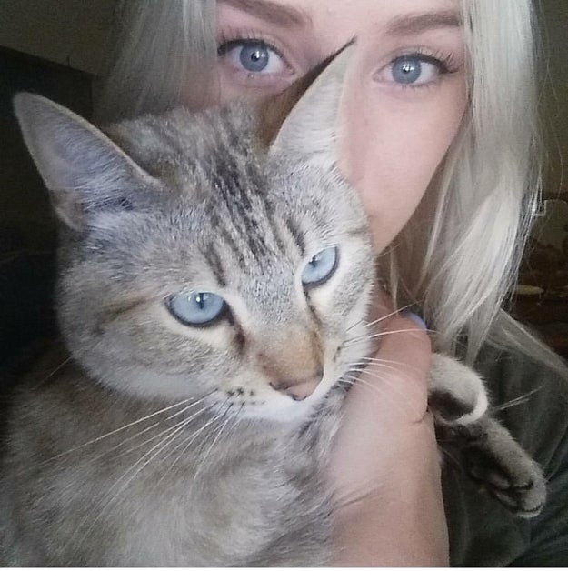 "This is 19-year-old Cristi Hanzel from Littlerock, California. And that's her cat who she's named Wednesday — ""after Wednesday Addams since they are both so sassy,"" she told BuzzFeed News."