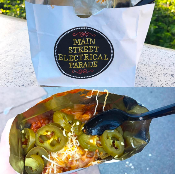"Where you can get it: Refreshment Corner on Main Street, U.S.A. at Disneyland.What we know about it: If you've ever enjoyed ""walking tacos"" (aka ""a taco in a bag""), you'll love this treat! For $4.59, you'll get corn chips, chili, shredded cheese, and some jalapeños in a bag you can take with you around the park!"
