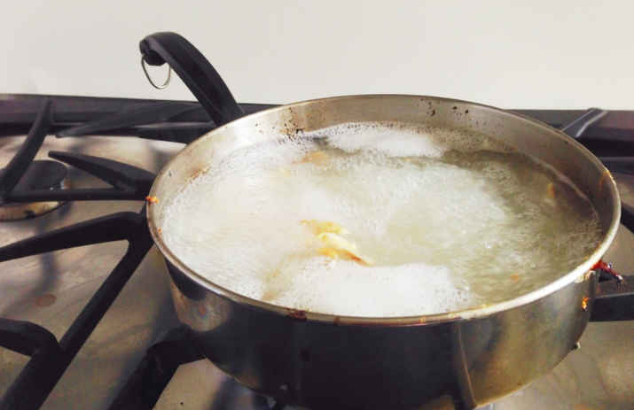 The heat will help remove stuck-on food from the bottom of the pan and make it much easier to scrub everything off.