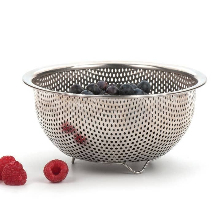 Simply fill it up with ice and put it in a larger bowl. That way the melted ice water will drip into the bowl and you won't have a water ice bucket. Get your own colander from Amazon for $9.18.