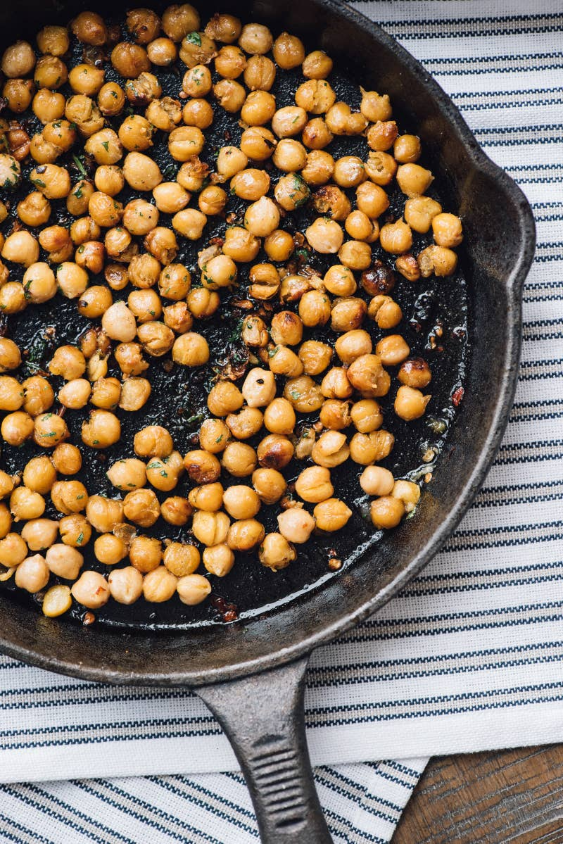 Ingredients: 1 can (15.5 oz) of chickpeas; 2 tablespoons olive oil; ½ teaspoon kosher salt; 2 teaspoons minced jalapeño; 1 tablespoon chopped cilantro. To make: Drain, rinse, and pat the chickpeas dry. Heat olive oil in a cast-iron pan. Add the chickpeas, salt, and minced jalapeño. Cook, stirring frequently, until chickpeas are brown and crispy, about 10 minutes. Remove from heat and toss with cilantro.
