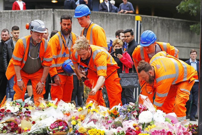 Construction workers lay flowers at a pedestrian crossing on the south side of London Bridge in tribute to the victims of the 3 June attacks.