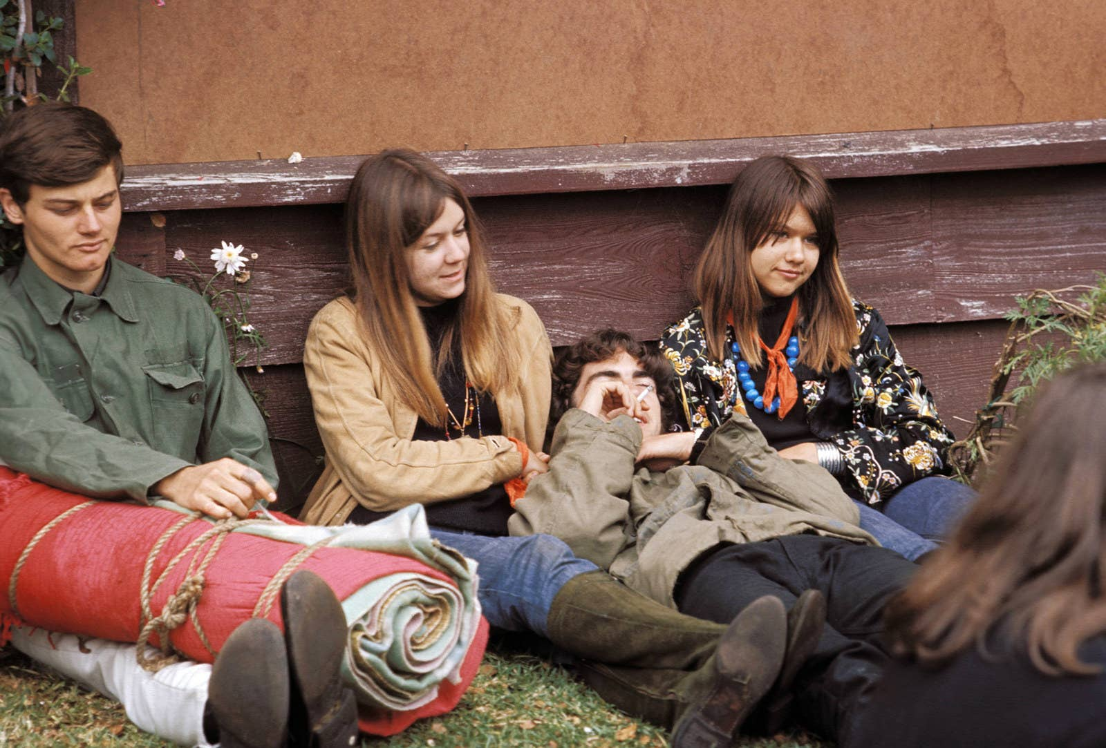 A group of hippies hang out during the Monterey Pop Festival.