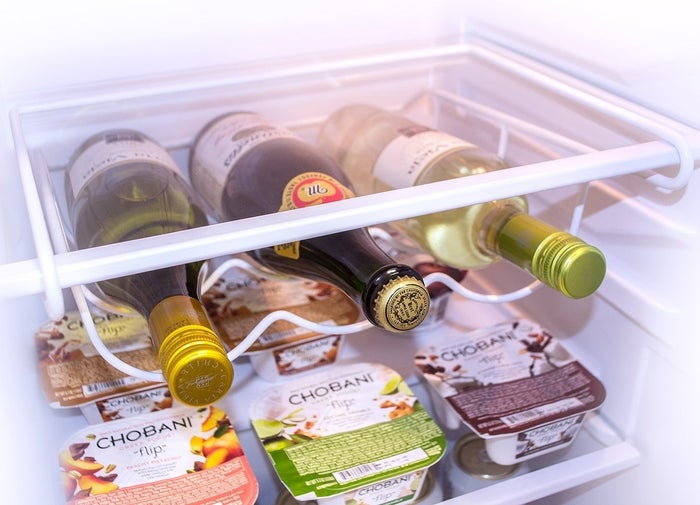 """Promising review: """"I love this rack! It makes my fridge look so much better and frees up room on the top shelf. We had company this weekend and when they opened the fridge the first thing they commented on was the wine rack and how """"cool"""" it is. Very simple to install and very sturdy."""" --Amazon CustomerGet it from Amazon for $11.99."""