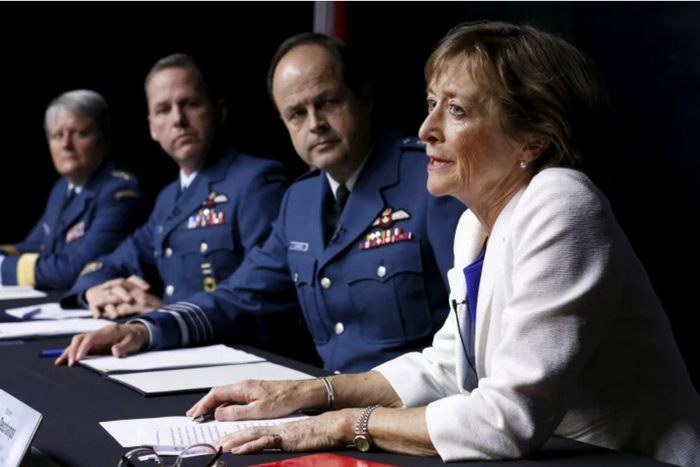 Former Supreme Court justice Marie Deschamps speaks after the release of a report on sexual misconduct in the Canadian Armed Forces, as then-chief of the defence staff Gen. Tom Lawson looks on.