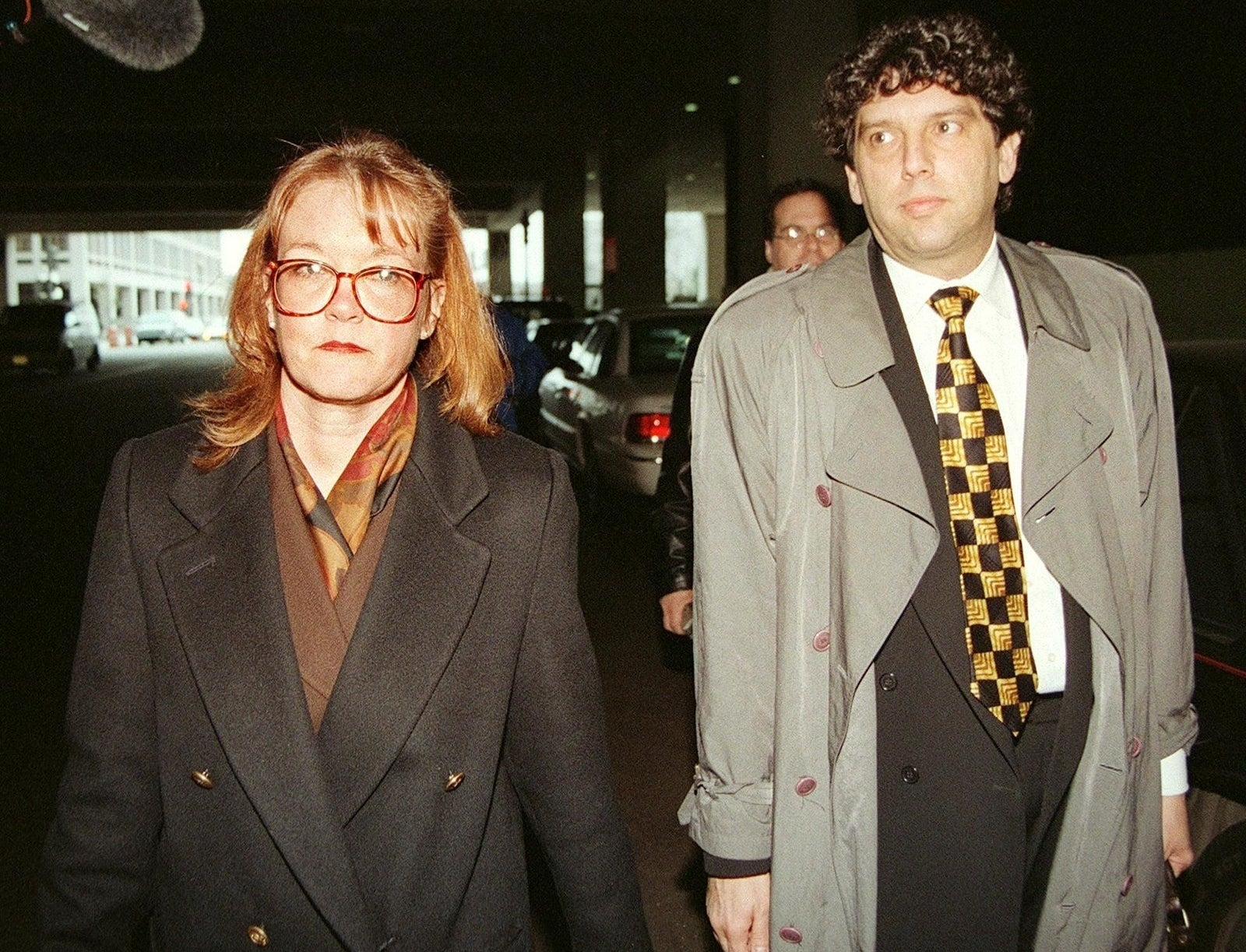 The range of staffers hauled before a grand jury included a National Archives staffer, Ellen McCathran, pictured here with her lawyer after her testimony in March 1998.