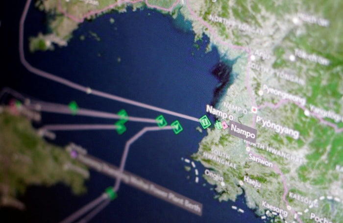 A ship-tracking screen shows cargo ships returning to Nampo.