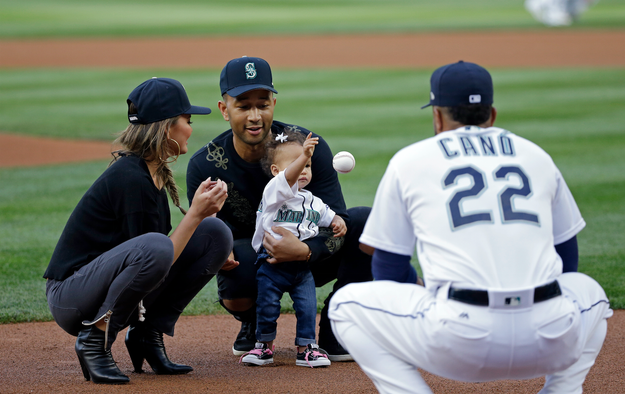 John Legend and Chrissy Teigen's 1-year-old daughter Luna threw the first pitch at a Seattle Mariners game on Tuesday.